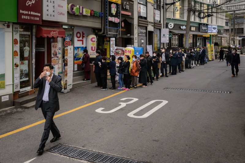 People line up to buy face masks in Seoul