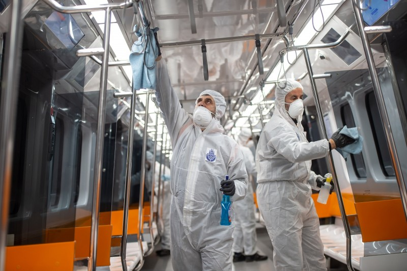 Employees of the Istanbul Municipality wearing protective gear disinfects a subway carriage to prevent the spread of the COVID-19, caused by the novel coronavirus, in Istanbul on March 12, 2020.