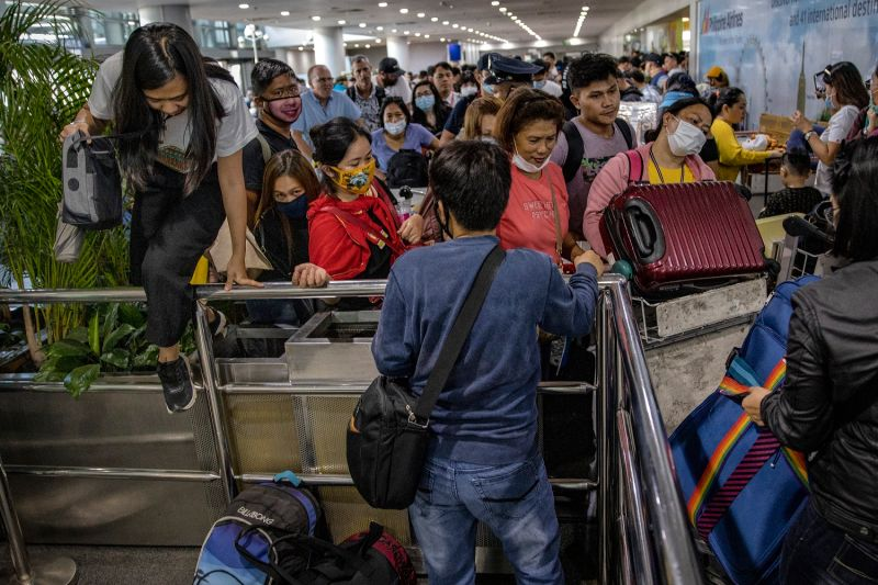 Filipinos hoping to get on flights out of Manila hours before it is placed on lockdown queue at Ninoy Aquino International Airport on March 14, 2020 in Manila, Philippines.