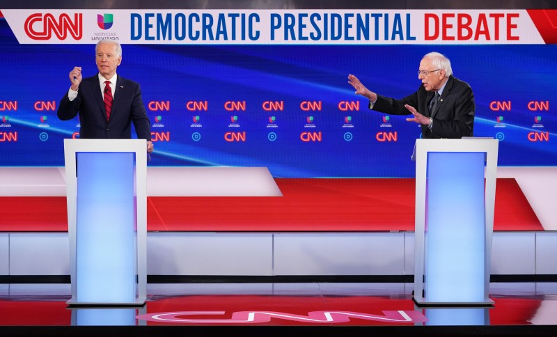 Former U.S. Vice President Joe Biden and Vermont Sen. Bernie Sanders square off at the Democratic presidential debate in Washington, D.C., on Mar. 15.