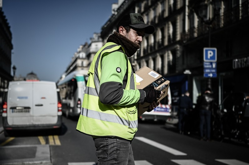 A man delivers an Amazon parcel in Paris