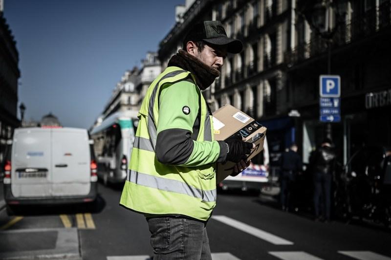 A man delivers an Amazon parcel in Paris