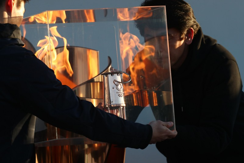 Using a lantern to preserve the Olympic flame