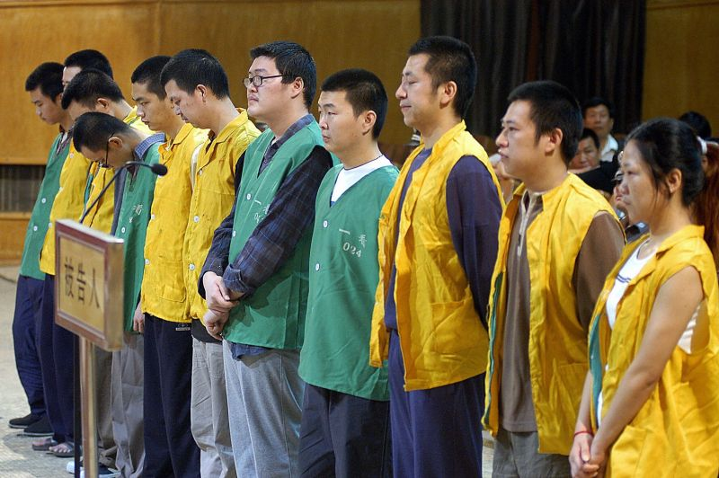 A group of 11 defendants charged with spreading pornography in China in 2005.
