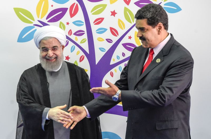 Iranian President Hassan Rouhani greets Venezuelan President Nicolás Maduro