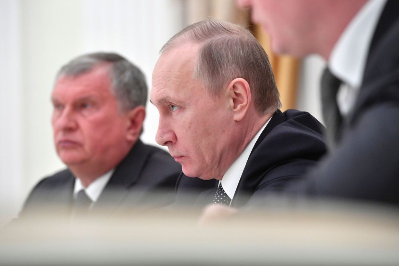 Russian President Vladimir Putin and Igor Sechin of Rosneft