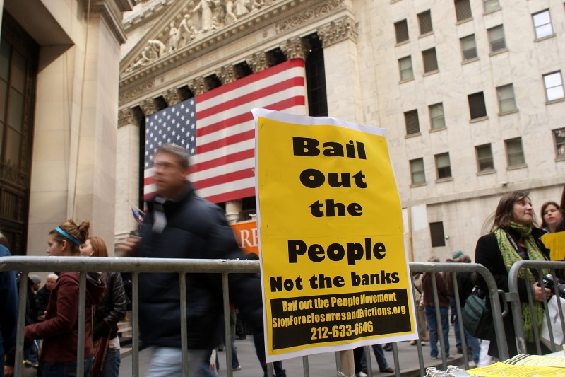 Demonstrators protest against government bailouts of banks in front of the New York Stock Exchange, in New York City on Oct. 24, 2008.