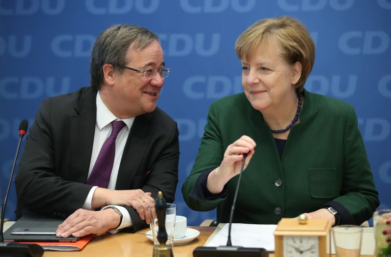 German Chancellor and leader of the German Christian Democrats (CDU) Angela Merkel chats with her colleague Armin Laschet, governor of North Rhine-Westphalia, at a meeting of the CDU leadership on Nov. 27, 2017 in Berlin, Germany.