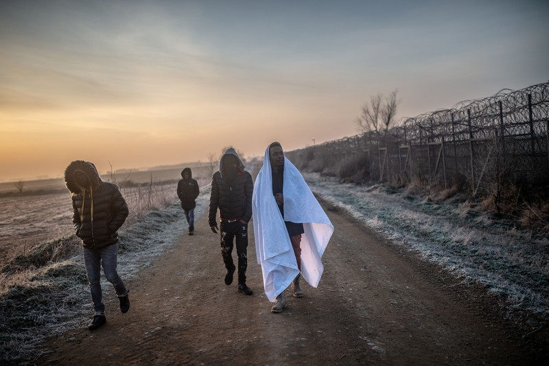 Migrants walk toward the Greek border in Pazarkule, in Turkey's Edirne district, on March 1, near where thousands of migrants stuck on the border clashed with Greek police on Feb. 29.