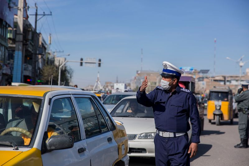 A policeman wearing a mask in Herat province, Afganistan