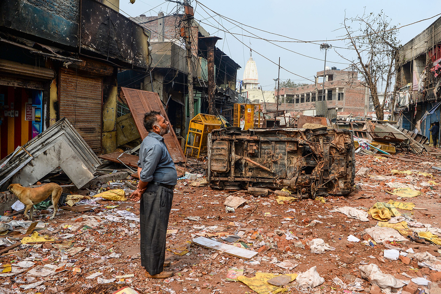 A resident looks at burnt-out and damaged residential premises and shops following clashes between people supporting and opposing a contentious amendment to India's citizenship law in New Delhi on Feb. 26. SAJJAD HUSSAIN/AFP via Getty Images