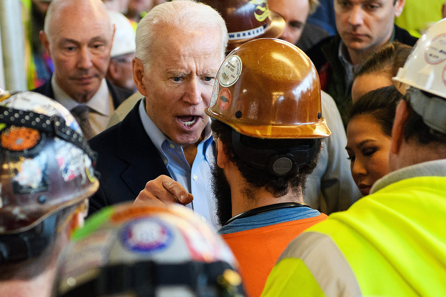 "U.S. Democratic presidential candidate Joe Biden has a heated exchange with a worker over gun control while touring the Fiat Chrysler plant in Detroit on March 10. The worker accused the former vice president of seeking to weaken the constitutional right to own firearms. ""You're full of shit,"" Biden shot back. ""I support the Second Amendment."" MANDEL NGAN/AFP via Getty Images"