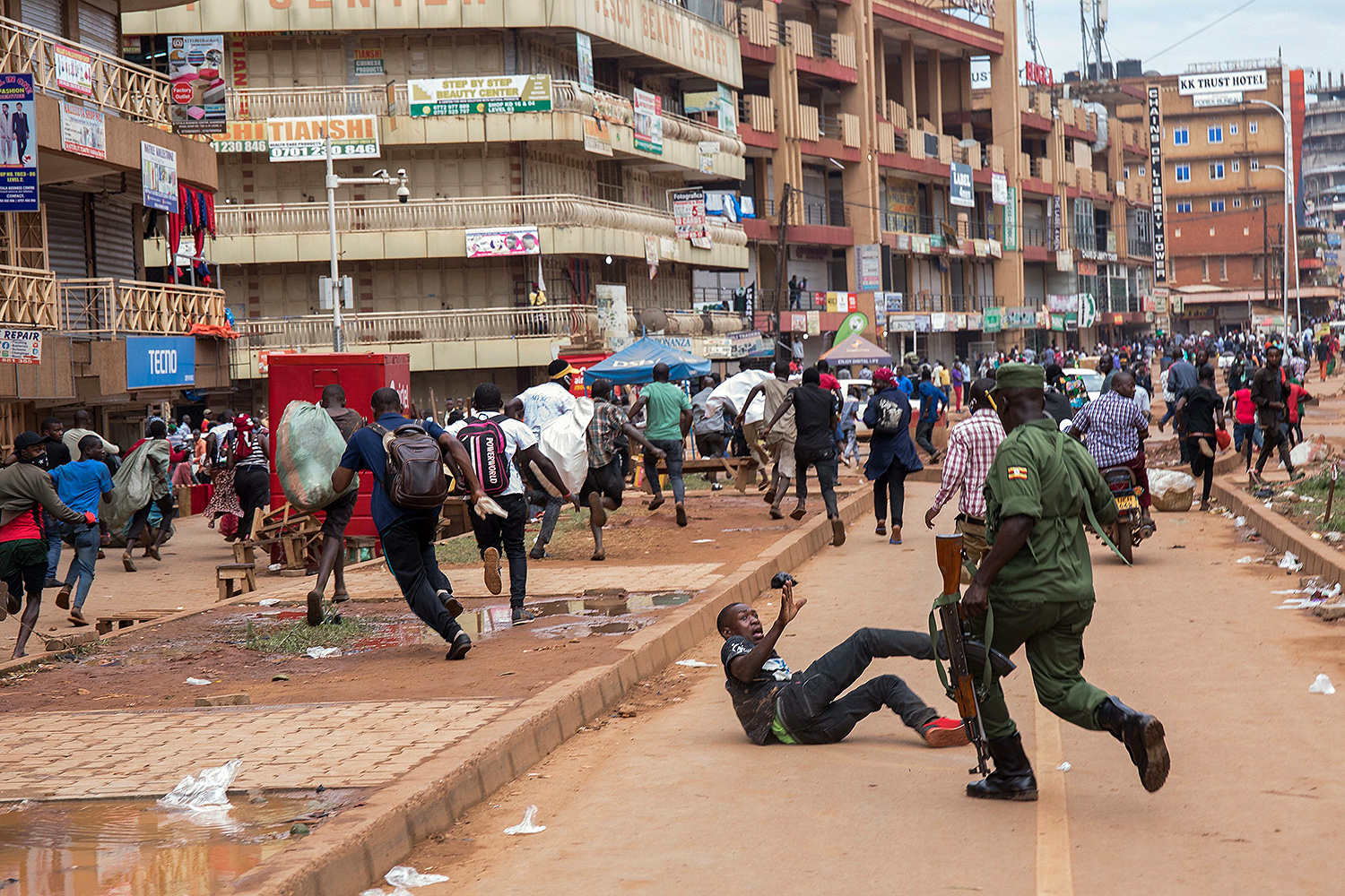 A police officer chases street vendors in Kampala, Uganda, on March 26 after the president directed the public to shelter in place for 32 days to curb the spread of the coronavirus. BADRU KATUMBA/AFP via Getty Images
