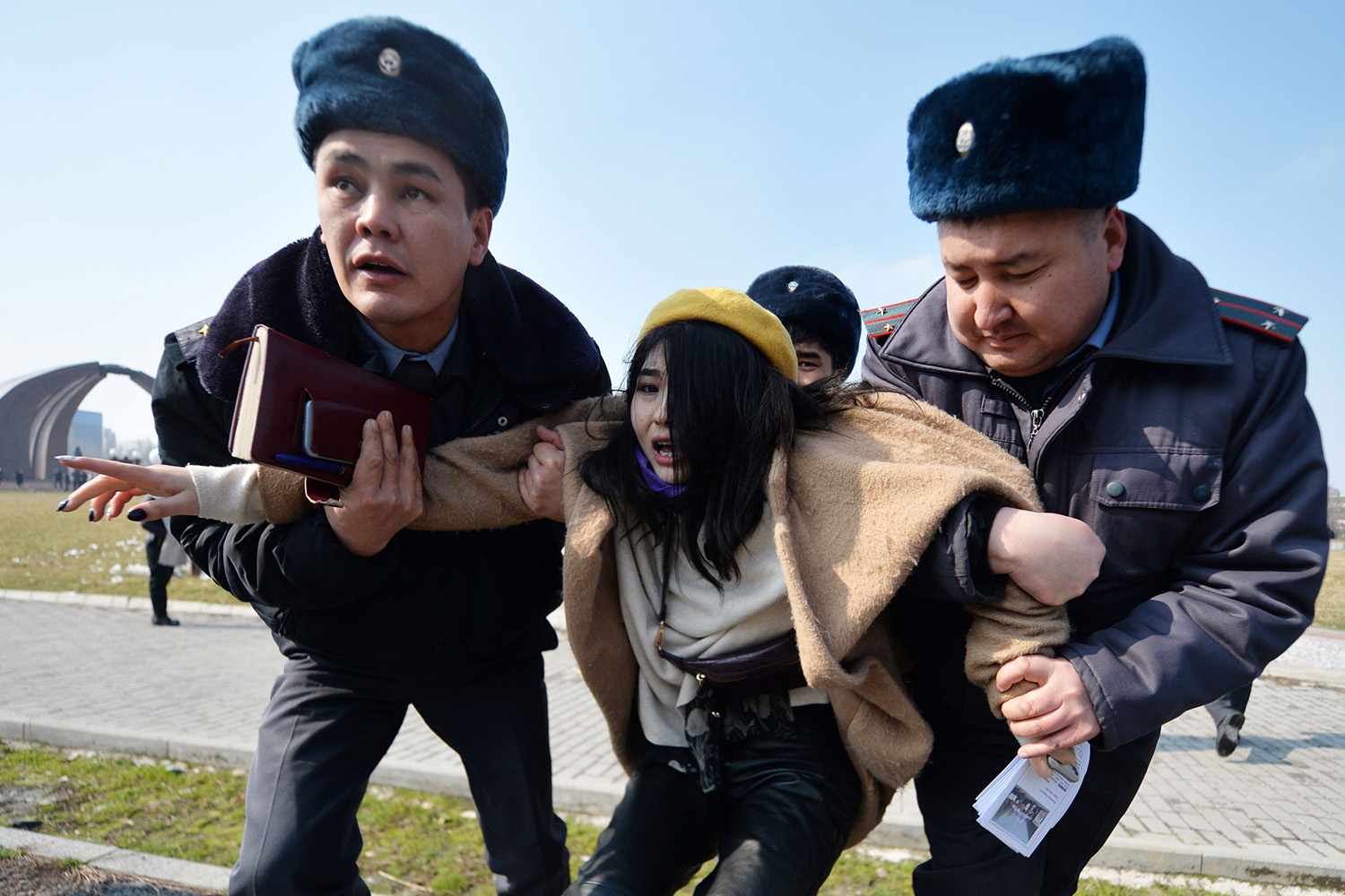 Police arrest a woman protesting on International Women's Day against gender-based violence in Bishkek, Kyrgyzstan, on March 8. VYACHESLAV OSELEDKO/AFP via Getty Images