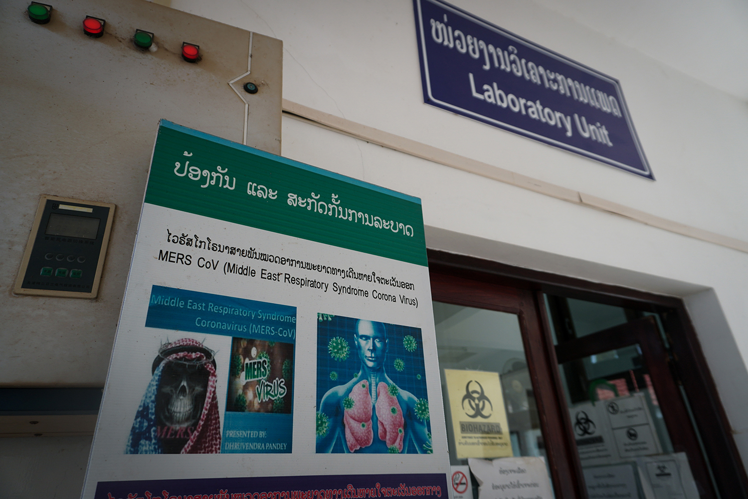 A warning poster outside a testing laboratory at a hospital in Laos on March 3. The government is slowly expanding its ability to test for coronavirus to provincial hospitals, but some doctors fear that cases are still going undetected.