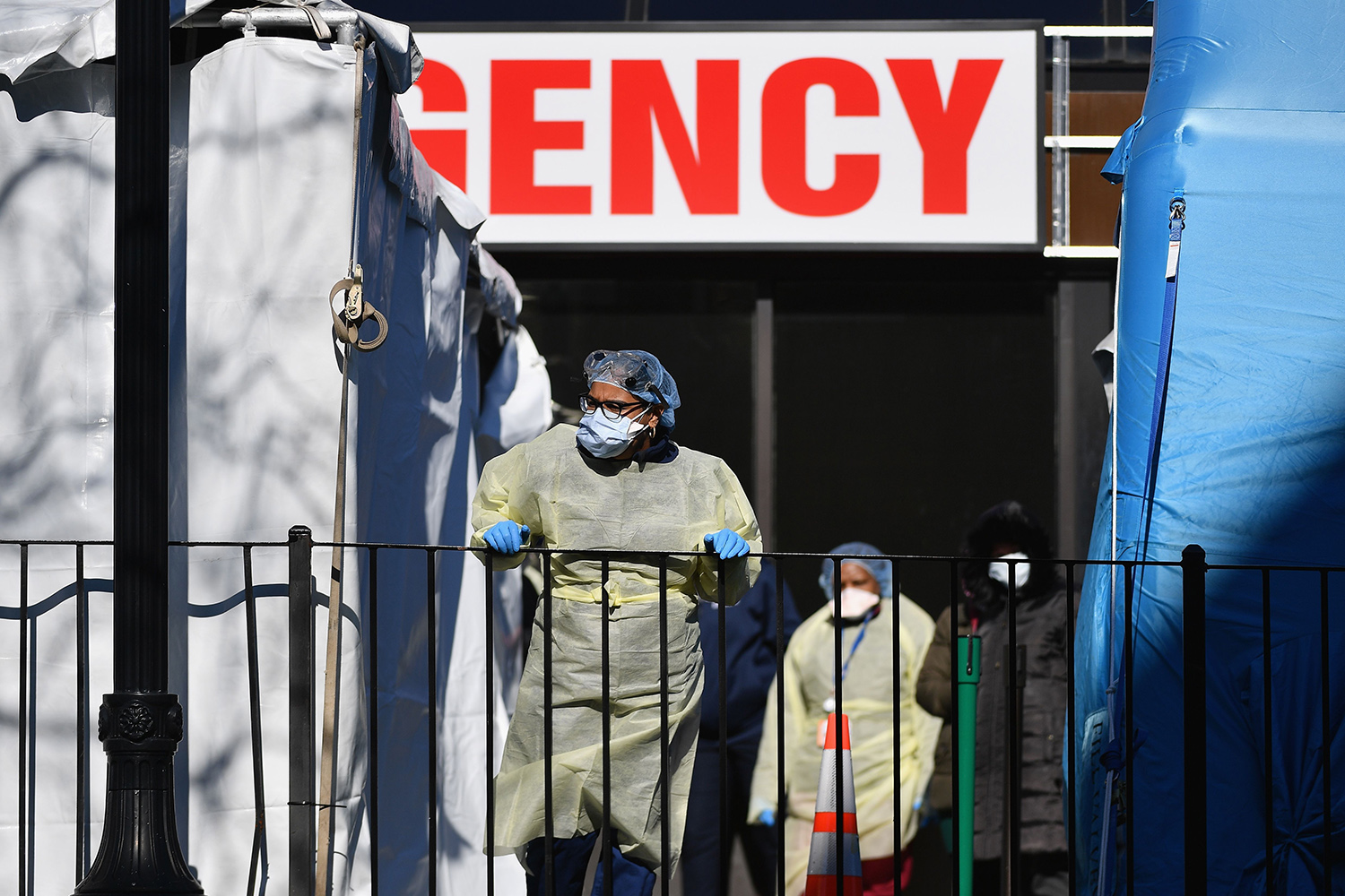 Medical workers step outside Elmhurst Hospital Center in the Queens borough of New York City on March 26. Elmhurst reported 13 deaths from coronavirus in a 24-hour span earlier that week. ANGELA WEISS/AFP via Getty Images