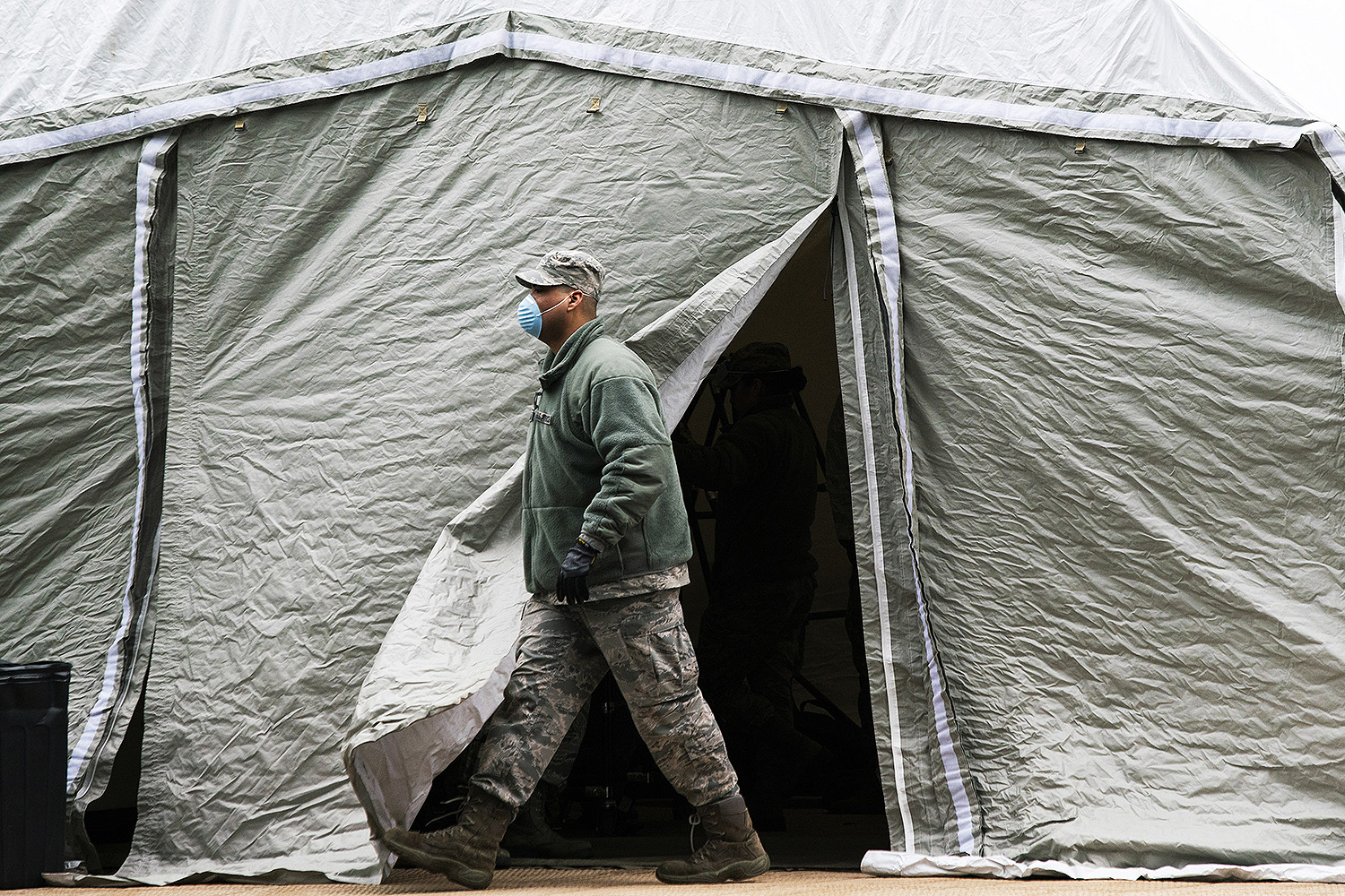 A member of the U.S. Air Force exits a makeshift morgue outside Bellevue Hospital in New York City on March 25. Eduardo Munoz Alvarez/Getty Images