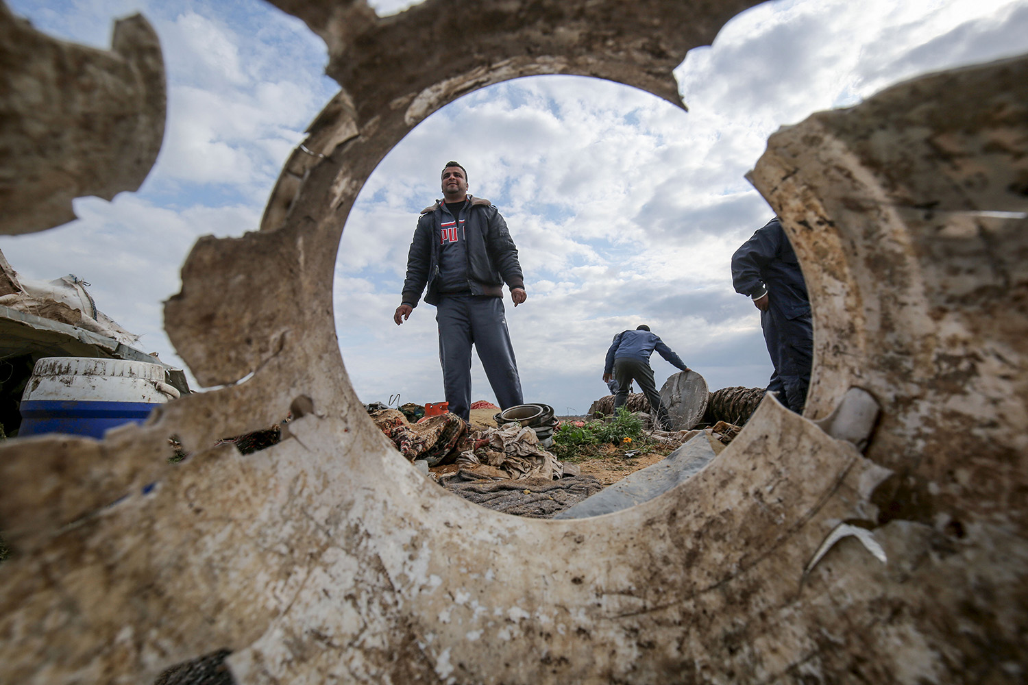 Palestinians salvage belongings from the site of an Israeli airstrike east of Khan Yunis in the southern Gaza Strip on Feb. 25. SAID KHATIB/AFP via Getty Images