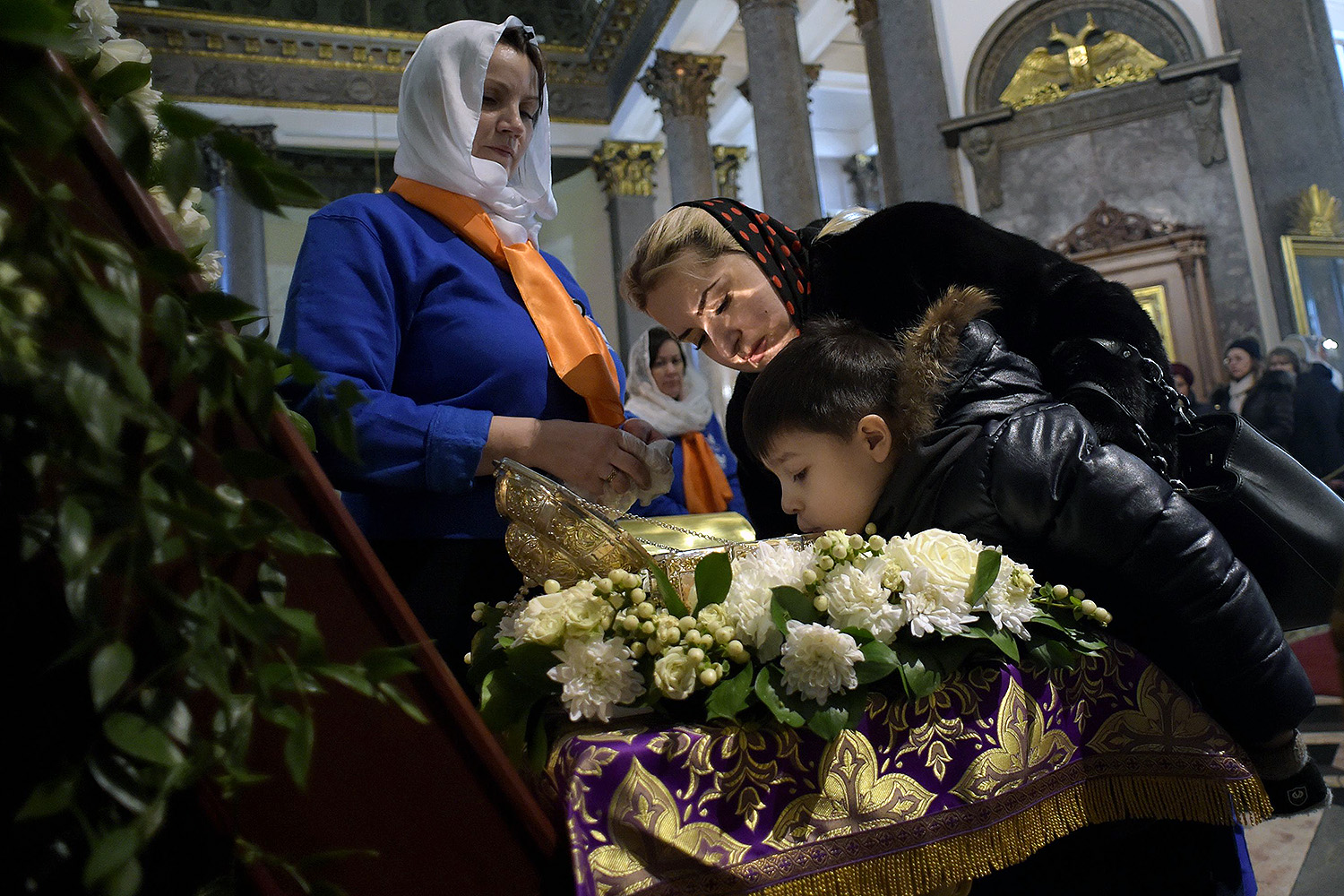Russian Orthodox believers kiss a relic of St. John the Baptist at Kazan Cathedral in Saint Petersburg on March 15. The shrine was on loan from Jerusalem for a week, and tens of thousands came out to kiss it. OLGA MALTSEVA/AFP via Getty Images