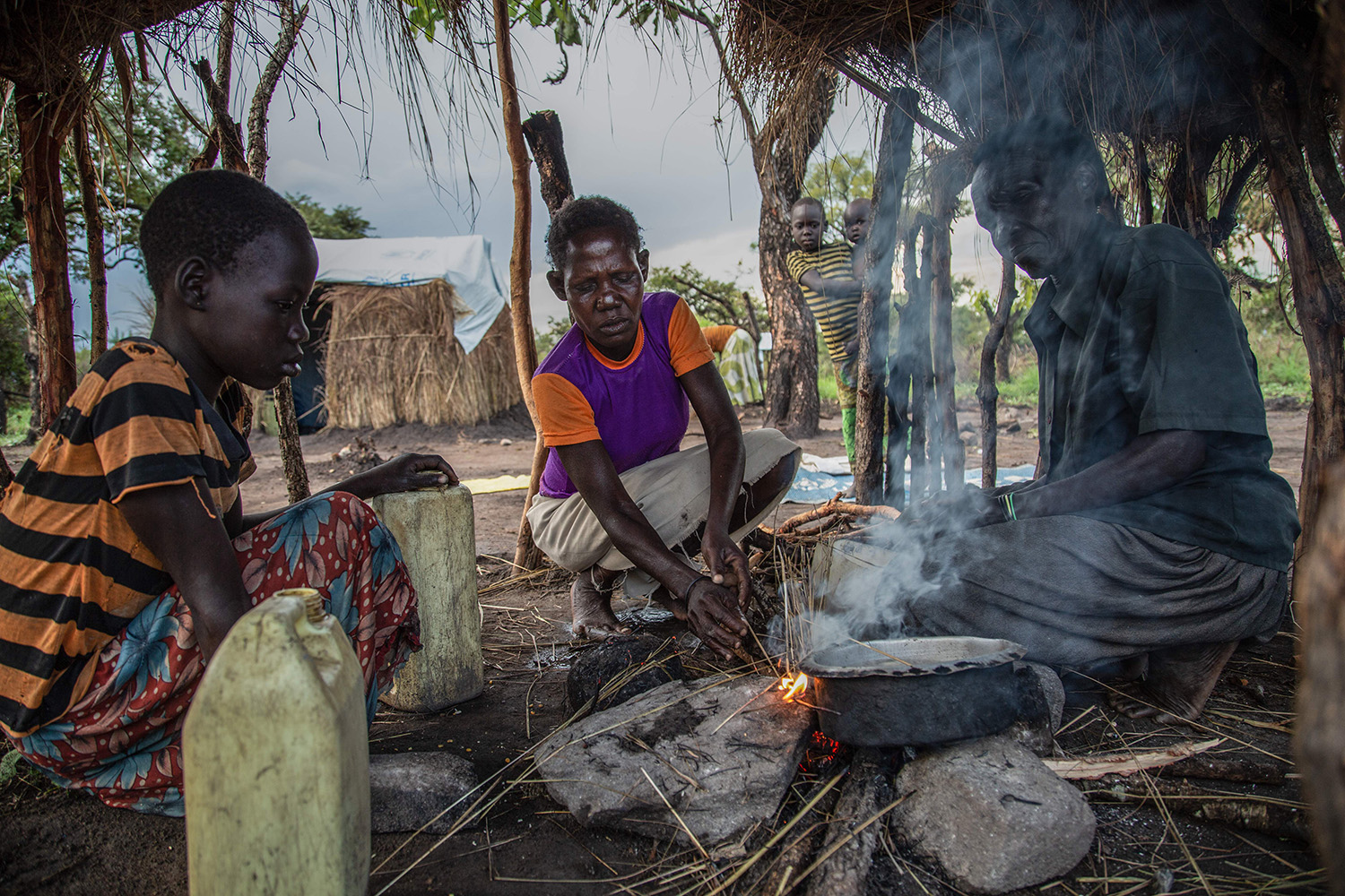 Internally displaced persons prepare food at the Korijo camp in South Sudan on Sept. 23, 2018. The country's civil war has caused its health care system to crumble over the past seven years, making it particularly susceptible to the spread of coronavirus.
