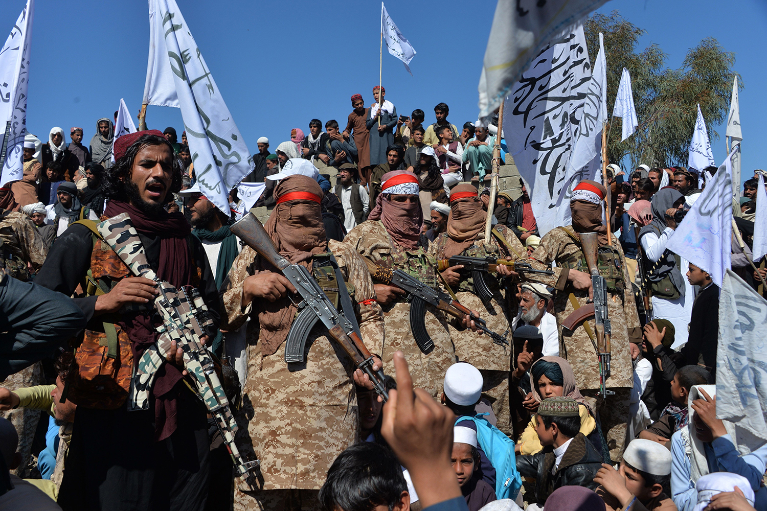 Afghan Taliban militants and villagers celebrate March 2 in the Alingar district of Laghman Province. The Taliban said they were resuming offensive operations against Afghan security forces, ending the partial truce that preceded the signing of a deal between the insurgents and Washington. NOORULLAH SHIRZADA/AFP via Getty Images