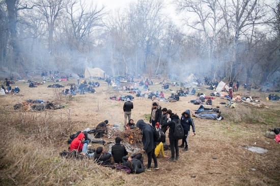Nearly 4,000 refugees from countries such as Afghanistan, Iran, Syria, Palestine, Bangladesh, and Morocco fan out into the Turkish military zone near the border with Greece on Feb. 29, collecting firewood from the forest to keep warm overnight.