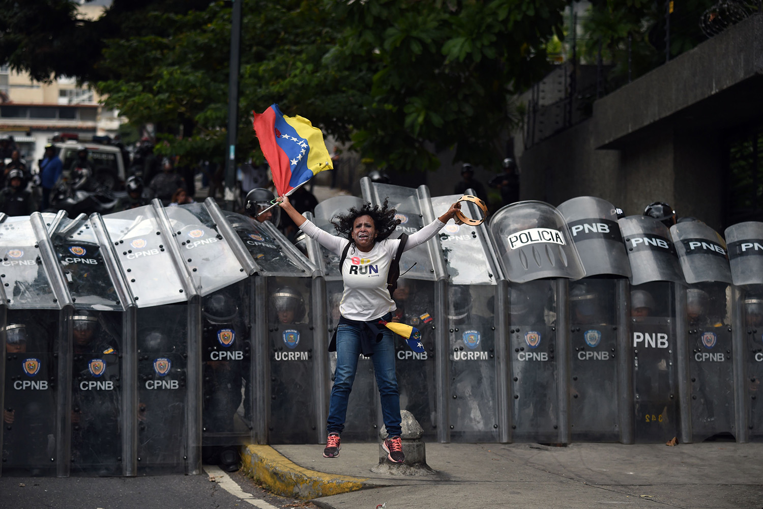 A supporter of Venezuelan opposition leader Juan Guaidó tries to block security forces from making their way to the National Assembly in Caracas on March 10. FEDERICO PARRA/AFP via Getty Images