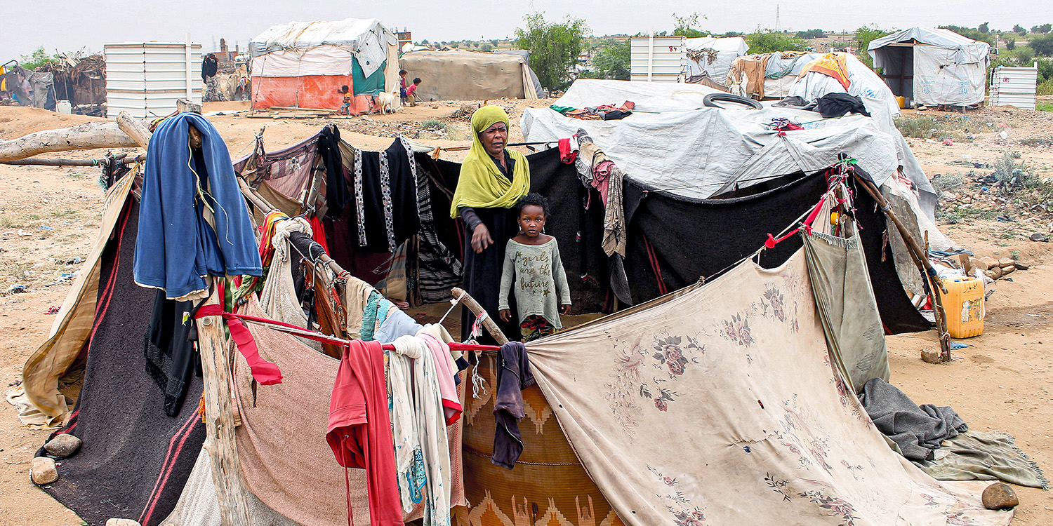 A woman and child sit together at a makeshift camp for displaced Yemenis in the northern Hajjah province Dec. 16. Coronavirus could have devastating consequences for Yemen, as its health care infrastructures are already overburdened after years of conflict.