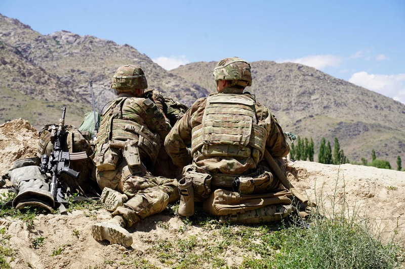 U.S. soldiers look out over hillsides during a visit by Gen. Scott Miller, the commander of U.S. and NATO forces in Afghanistan, at an Afghan army in Wardak province on June 6, 2019.