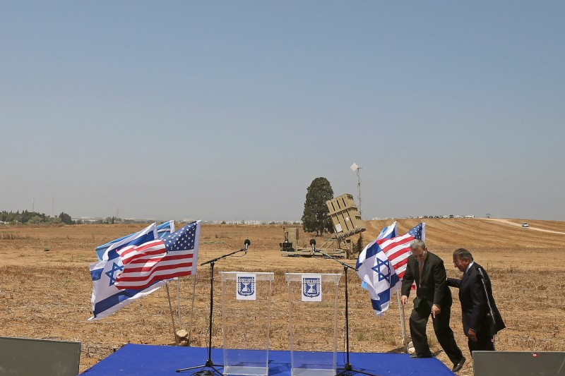 Israeli Defense Minister Ehud Barak (L), and U.S. Defense Secretary (R) Leon Panetta walk to the podium to speak to the media at a joint press conference while they visit the Iron Dome defense system launch site on August 1, 2012 in Ashkelon, Israel.
