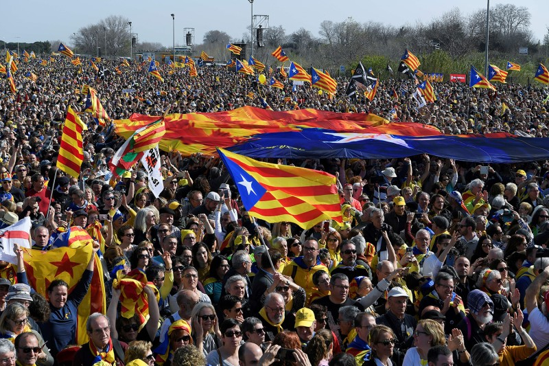 Supporters hold a giant Catalan flag