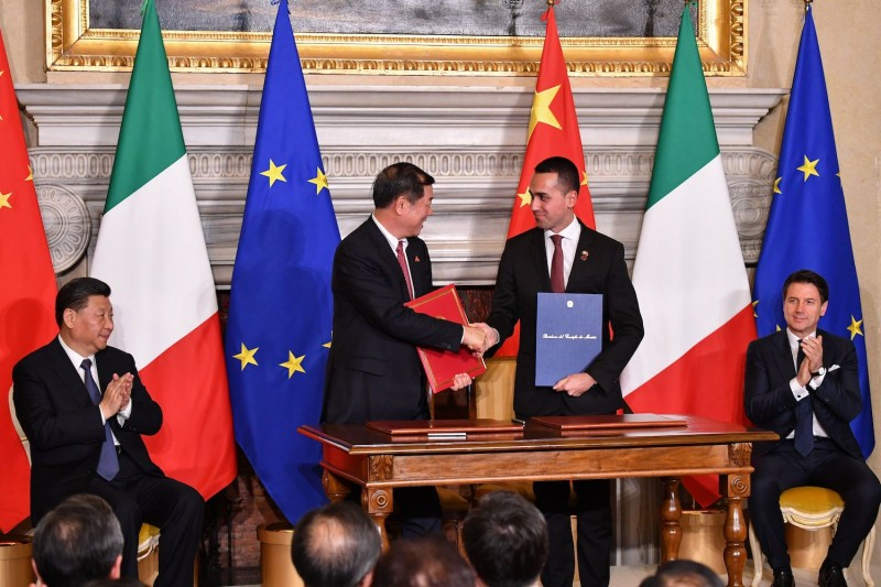 From left: Chinese President Xi Jinping; He Lifeng, the chairman of China's National Development and Reform Commission; Italian Labor and Industry Minister and Deputy Prime Minister Luigi Di Maio; and Italian Prime Minister Giuseppe Conte attend a signing ceremony following their meeting at Villa Madama in Rome on March 23, 2019.