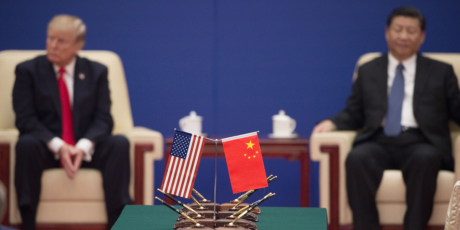 U.S. President Donald Trump and Chinese President Xi Jinping attend a business leaders event in Beijing on Nov. 9, 2017.