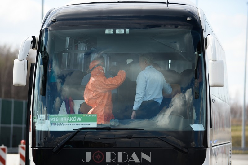 A health worker wears a protective suit as he screens bus passengers near the Czech border in Gorzyczki, Poland, on March 10.