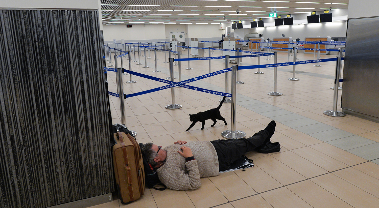 A traveler waits in the near-empty departure hall of Terminal 1 at the Ben Gurion Airport in Tel Aviv-Yafo, Israel, on March 10.