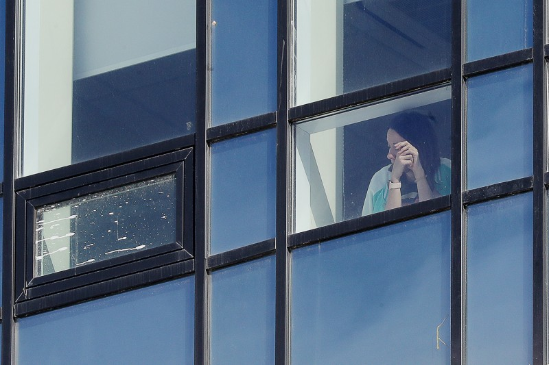 A woman looks out of a window at the Novomoskovsky multipurpose medical center for patients suspected of having the coronavirus in Moscow on March 16.
