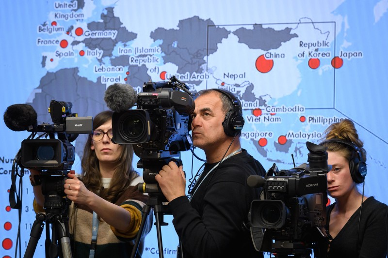 Camera operators set up in front of a maps showing the distribution of coronavirus cases worldwide during a daily briefing at the World Health Organization headquarters in Geneva, Switzerland, on Feb. 28.