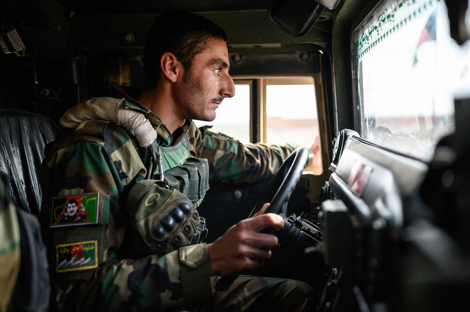 Hebaidullah Parwani of the Afghan National Army patrols with a convoy in Jowman district, along the main highway between Lashkarga and Kandahar, on Nov 19, 2019.