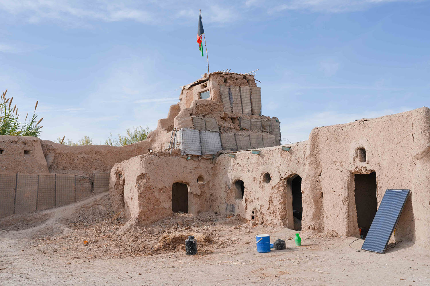 An ANA outpost sits along the main road between Lashkargah and Kandahar on Nov. 19, 2019. A network of small underground tunnels dug by the soldiers offer a final fallback position in the event that the outpost is overrun by Taliban forces. A single solar panel provides the only electricity.