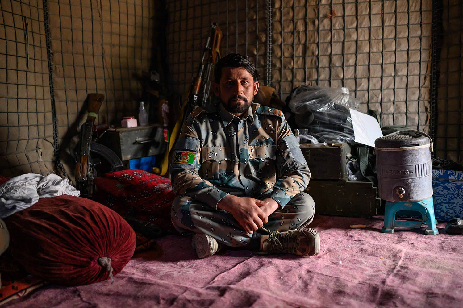 ABP Col. Ahmad Sagoori, 36, sits in the storage room of his small outpost in Nahr-e-Saraj district, in Helmand province, on Nov. 20, 2019.