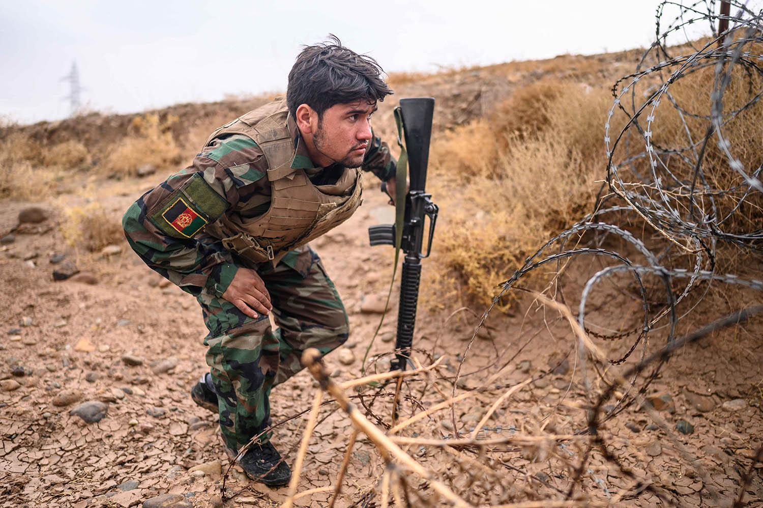 A young ANA soldier searches for Improvised Explosive Devices in a culvert beneath the main Lashkargah-Kandahar highway on Nov. 21, 2019. IEDs remain one of the most commonly employed weapons of the Taliban in this area.