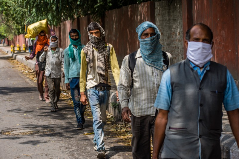 A group of migrant workers and laborers walk toward Uttar Pradesh as the nationwide lockdown continues over the coronavirus.