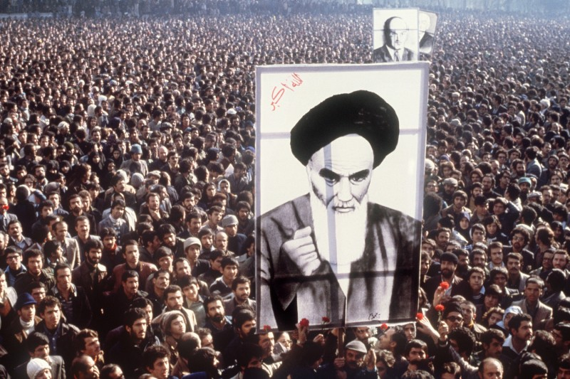 Demonstrators hold a poster of Ayatollah Ruhollah Khomeini, in January 1979, in Tehran, during a demonstration against the shah.