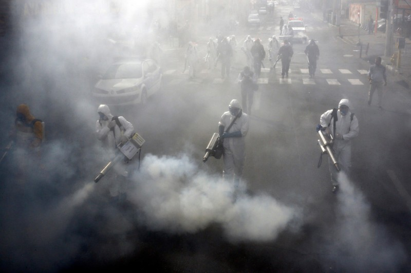 Iranian firefighters disinfect streets in Tehran in a bid to halt the spread of the coronavirus on March 13.