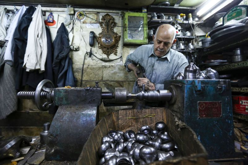 A craftsman works at a workshop in Tehran