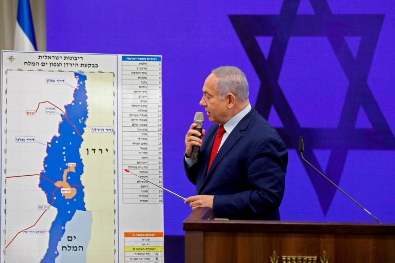 Israeli Prime Minister Benjamin Netanyahu point to a map of the Jordan Valley as he gives a speech in Ramat Gan on Sept. 10, 2019.