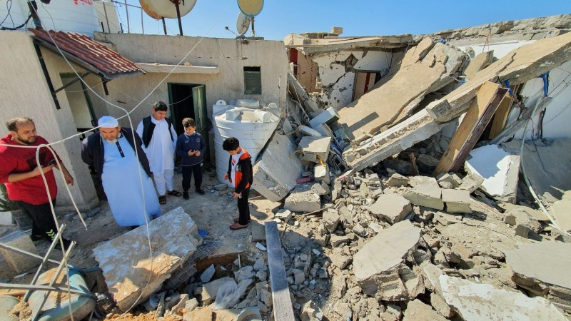 People inspect the damage inside a building following a rocket attack by forces loyal to eastern Libyan strongman Khalifa Haftar.