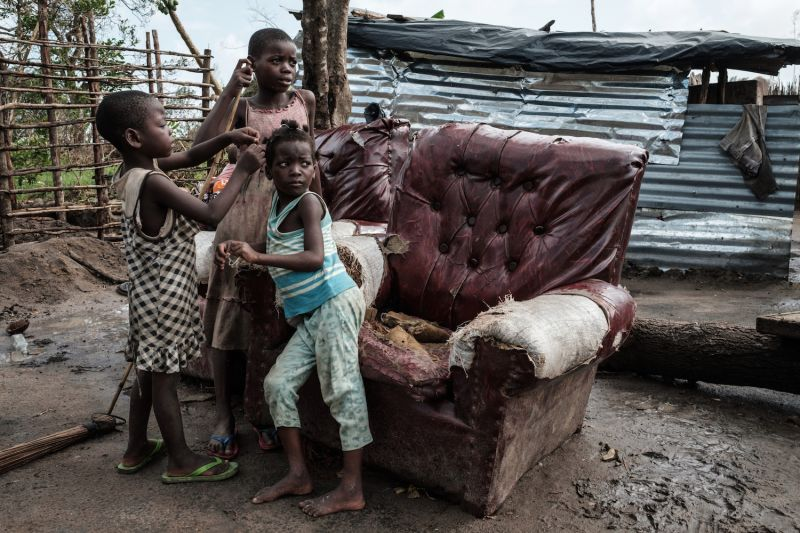 Children play in front of a house destroyed by Cyclone Idai in Beira, Mozambique, on March 27, 2019.