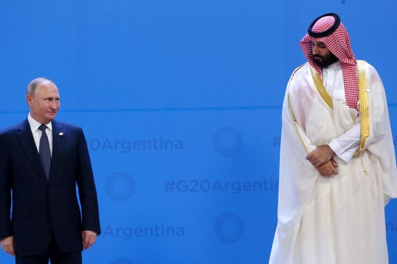 Russian President Vladimir Putin looks up at Crown Prince of Saudi Arabia Mohammad bin Salman al-Saud at the G20 summit in Buenos Aires on Nov. 30, 2018.