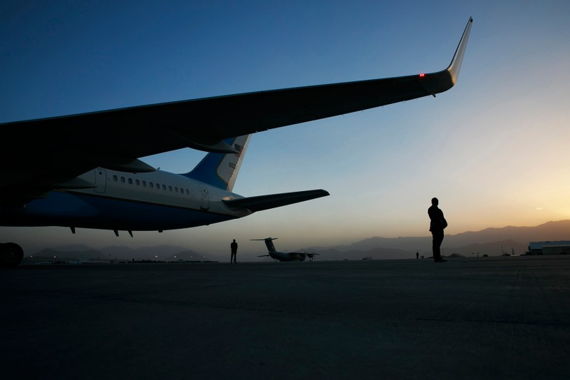Security stands watch as a helicopter carries U.S. Secretary of State Mike Pompeo back to his plane after meetings in Kabul, Afghanistan, on June 25, 2019.